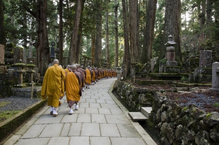 Buddhist monks walking to a temple in Koya-san, Japan