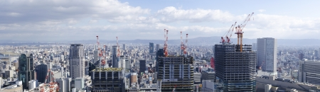 Panorama view the construction of three skyscrapers in Osaka