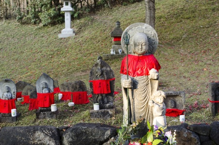 mantles: Small buddha statues with red mantles in Nara, Japan