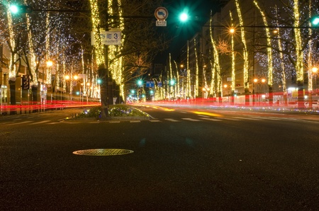 View of Mido-suji street in Osaka at night in December with street lights Editorial