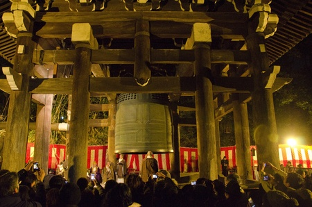The largest temple bell of Japan at Chion-in in Kyoto at new years Eve with monks ringing the bell