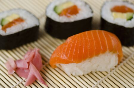 Japanese Cuisine, Sushi Set with Salmon, sushi rolls and gari ginger  photo