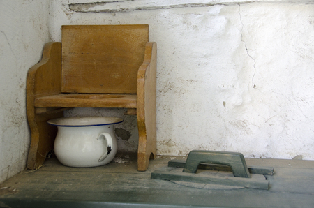 chamber pot: Old toilet with chamber pot an wooden chair