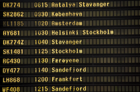 nordic country: Airport departures information board nordic country - air travel background Editorial