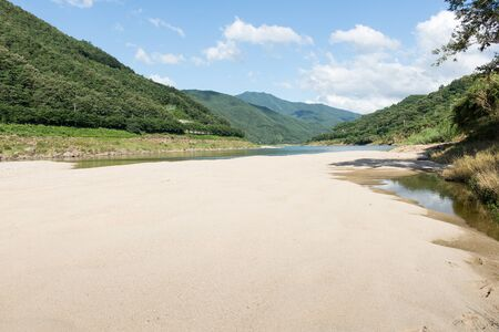 river bed: River bed landscape in South Korea with sandbank and green mountains Stock Photo