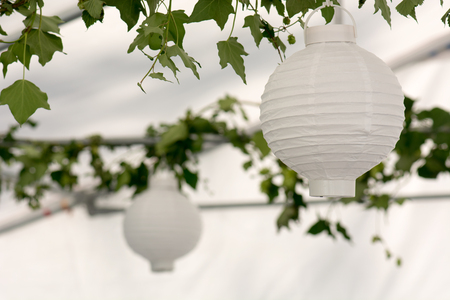 Lanterns in a summer pavilion with ivy leave decoration