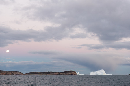 icefjord: Moon icebergs and dramatic sky ocean landscape in Greenland