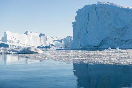 icefjord: Beautiful Icebergs in Disko Bay Greenland around Ilulissat with blue sky Stock Photo