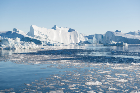 icefjord: Beautiful Icebergs in Disko Bay Greenland around Ilulissat with blue sky Stock Photo