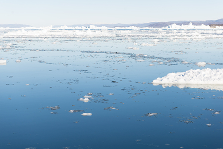 icefjord: Beautiful Landscape in Greenland with Ice, mountains and blue Sky
