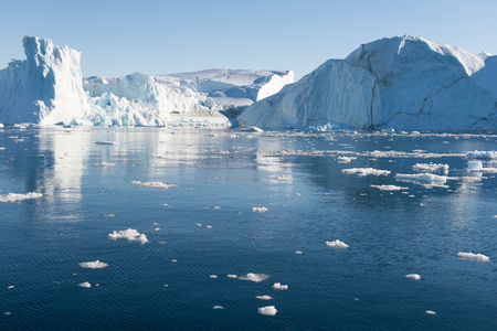 icebergs: Beautiful Icebergs in Greenland with blue Sky