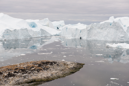 icefjord: Arctic landscape in Greenland around Disko Island and Ilulissat with icebergs