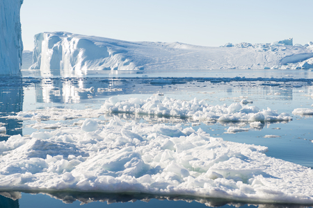 icefjord: Beautiful Icebergs in Greenland with blue Sky