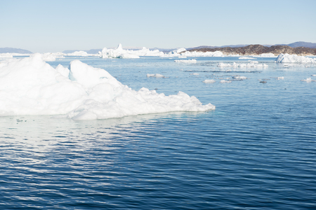 icefjord: Beautiful Landscape in Greenland with mountains, Icebergs and blue Sky Stock Photo