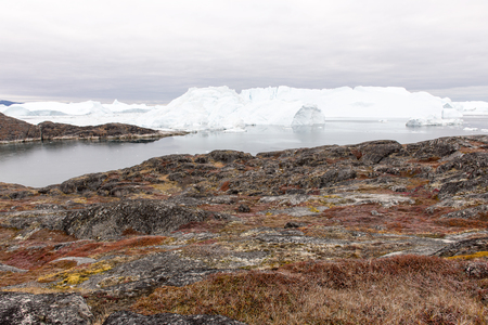 icefjord: Arctic landscape in Greenland around Disko Island with icebergs