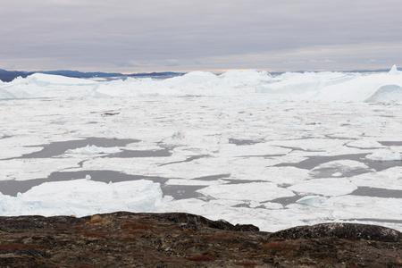 icefjord: Arctic landscape in Greenland around Disko Island with icebergs