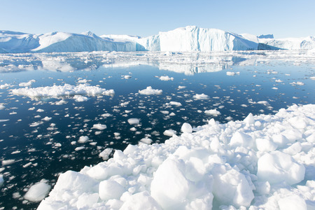 Beautiful Icebergs in Disko Bay Greenland around Ilulissat with blue sky Stock Photo