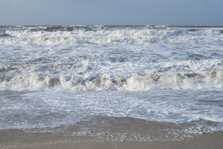 Stormy sea as seen from the beach with high waves