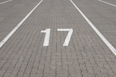 numbering: Ferry lane number 17 painted white on paving stone