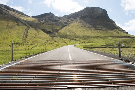 cattle grid: Cattle grid on the Faroe Islands with mountain in the background Stock Photo