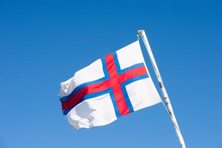 flag pole: Flag of the Faroe Islands on a white flag pole