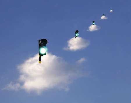 go ahead: Green traffic lights floating on clouds, suggesting receiving the go ahead ,  permission of safety