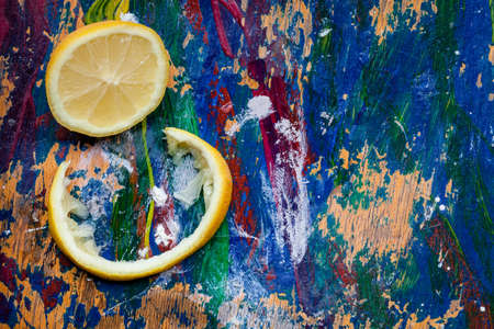 room for your text: Lemon parts arranged on a colourful background, plenty of room for your text Stock Photo