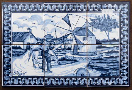 Obidos, Portugal - May 18, 2018: Souvenir azulejo panel of tiles as soldin  the charming medieval town Obidos in Portugal. Very popular tourist destination Editorial