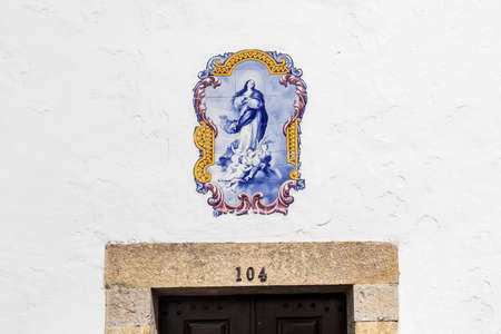 Obidos, Portugal - May 18, 2018: Azulejo  tiles as above a souvenir shop in the charming medieval town Obidos in Portugal. Very popular tourist destination