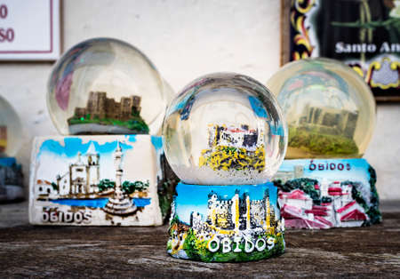 Obidos, Portugal - May 18, 2018: Snow globes in a souvenir shop in the charming town of Obidos, Portugal