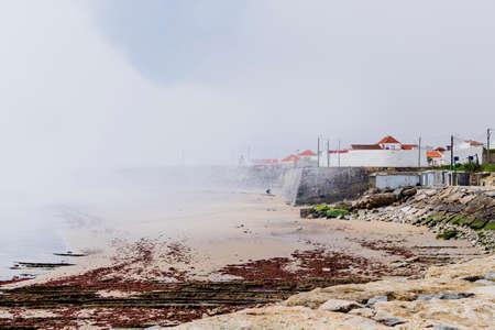 Peniche, Portugal - A sudden mist bank over the coast of Peniche Portugal Stock Photo