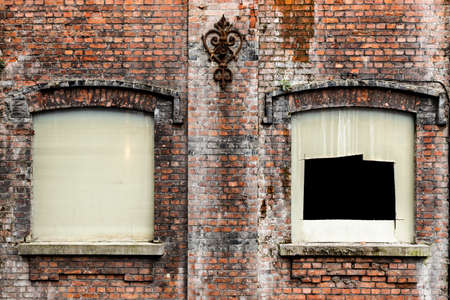 Urban textures - Rustic red brick wall with windows