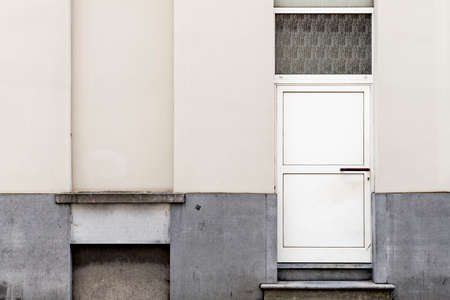 Real urban textures - Old white door n a yellowed wall
