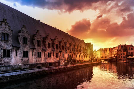 Ghent, Belgium - March 28, 2019: The Vleeshuis or Butchers House as seen from the river Leie Reklamní fotografie - 137283854