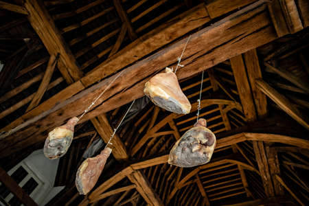 Dried hams hanging from the ceiling in the Vleeshuis or Butchers House