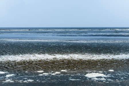 Oostduinkerke, Belgium, April 2019: abstract blue seascape Banco de Imagens