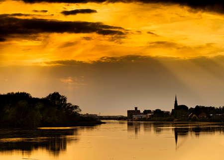 Boom, Belgium: Beuatiful sunset over the river Rupel