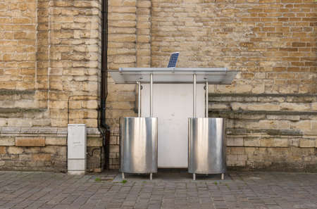 A shining public toilet with two urinals Imagens