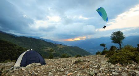 Camping Tent and Paraglider at the Summit Stock Photo