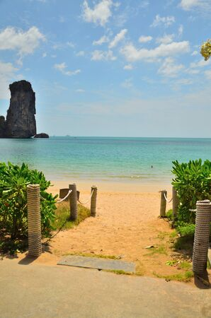Photo of the pathway go to the beautiful beach and sea with clear sky. This photo take at Krabi, Thailand. photo