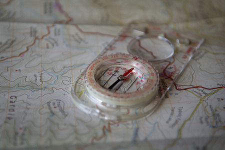 off path: A compass on a geophysical map.