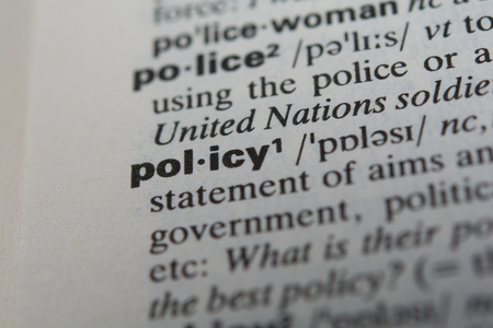 Definition of the word policy, close up photo