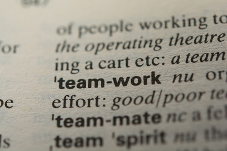 combined effort: Definition of the word teamwork, close up Stock Photo