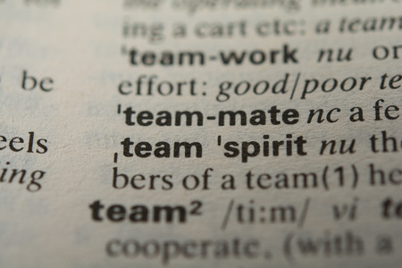 Definition of the word teammate, close up photo