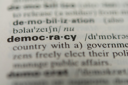 minister: Definition of the word democracy, close up Stock Photo