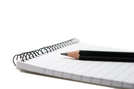 Black pencil with notepad isolated on white photo