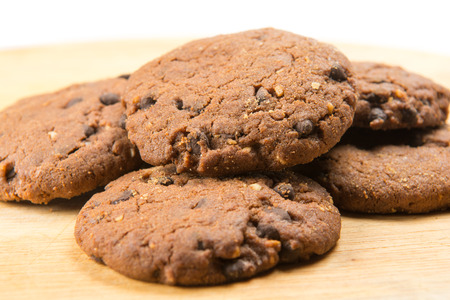 choco: Close up of delicious homemade choco cookies on a wooden plate Stock Photo
