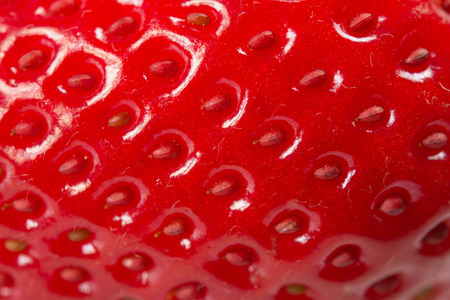 red taste: Extreme close up of fresh strawberry texture
