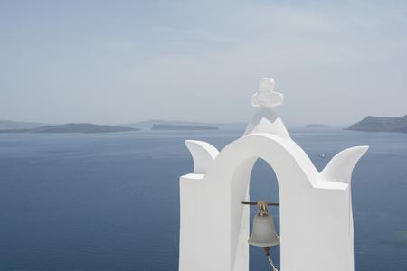 White belfry at Oia village, Santorini island, Greece