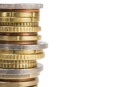investment banking: row of different coins. clise up, isolated on white Stock Photo